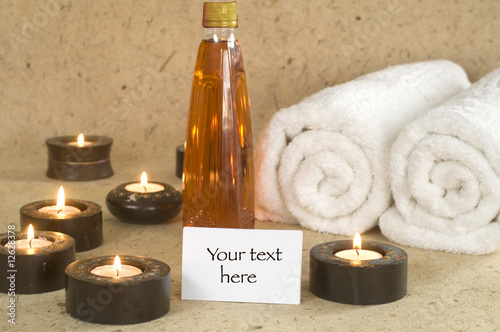 Massage oil with candles with invitation