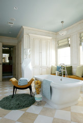 Side view of a bathtub in a bright elegant bathroom
