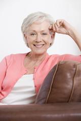 A senior woman sitting on a sofa