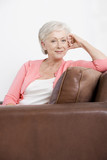 A senior woman sitting on a sofa