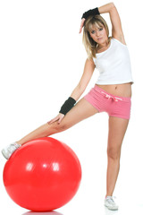 Pilates girl streaching on fitball