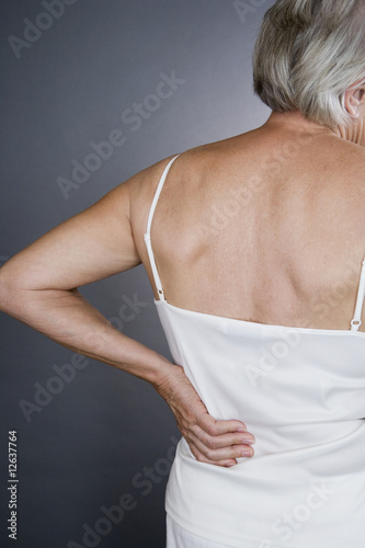 A senior woman with backache