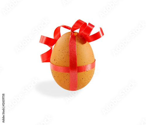 Egg with pink ribbon on white with clipping path. - 12639758