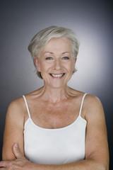 A senior woman laughing