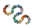 Coloured curved lines of crystal healing stones