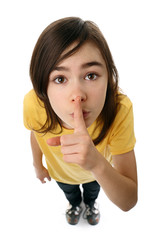 Young girl with her finger on her mouth