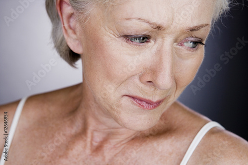 A senior woman crying