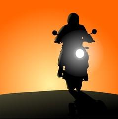 moto al tramonto