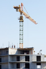 Construction site with crane against blue sky