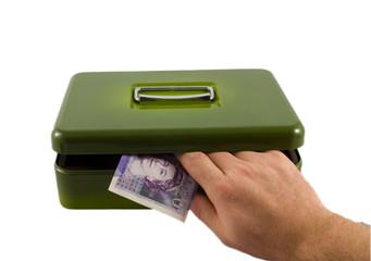 Hand in Cash Tin