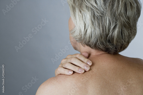 A senior woman with back ache