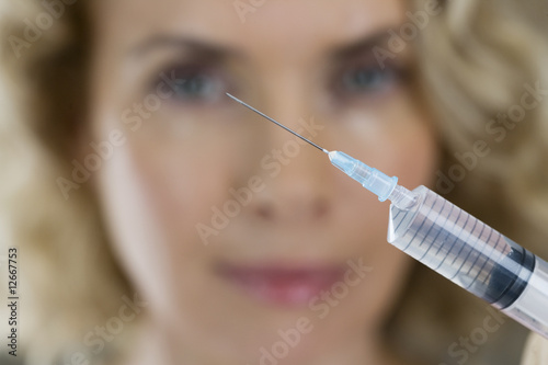 A middle aged woman having a collagen or botox injection