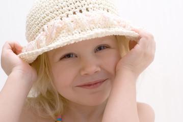Little girl in a hat