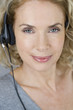 A middle aged woman wearing a headset