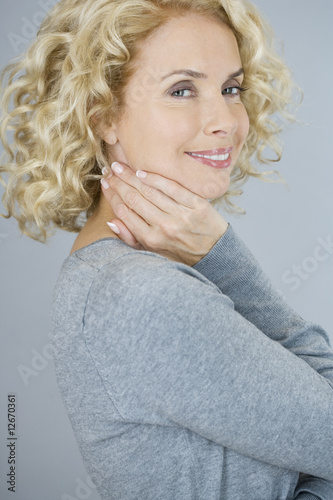 A portrait of an attractive middle-aged woman, smiling