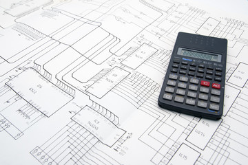Engineer table with schematics and calculator