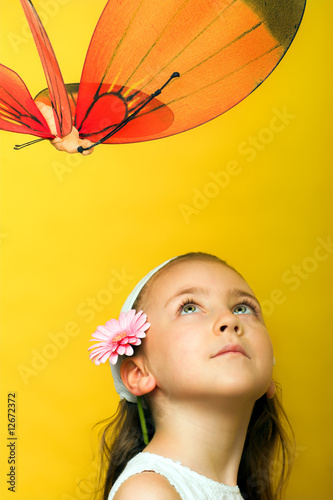 smiling beautiful  young girl with a butterfly at spring
