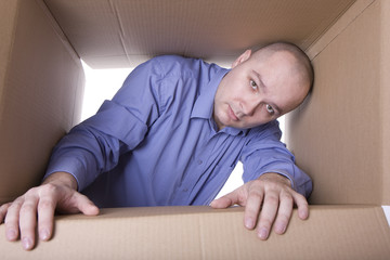 man inside cardboard box