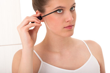 Body care series - young model applying mascara