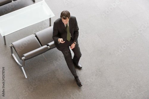 A businessman looking at his mobile phone