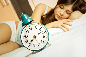 sleeping woman with the alarm clock