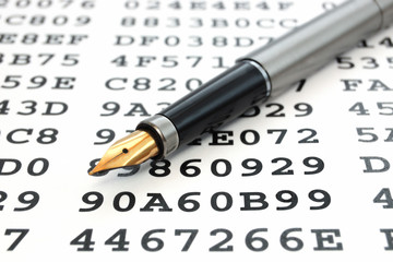 A gold-nibbed pen on a sheet with encrypted data
