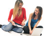 two young girls work on laptop isolated