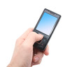 black mobile phone with blue screen in left hand isolated