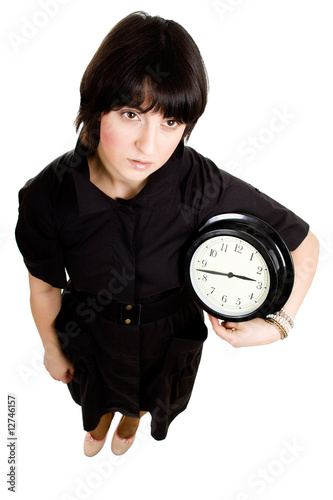 Cacasian woman holding wall clock