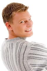 smiling male looking backward