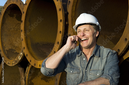 happy construction worker on cellphone