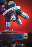 Microscope lens turret on orange poster