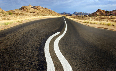A warped road  ahead in Namibia in Africa.
