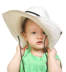 baby girl in a big white hat