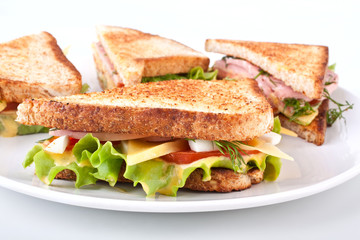 meat, lettuce and cheese club sandwich on toasted bread
