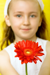 smiling beautiful  young girl with flower at spring