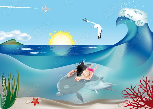 Bimba che nuota con i delfini