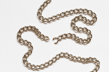 Nice torn chain with shadow lying on white background