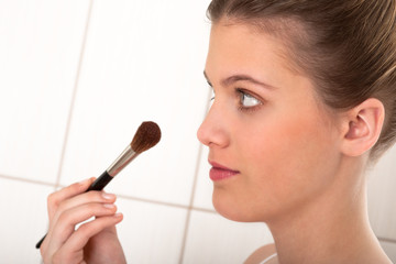Body care series - Young lady applying powder