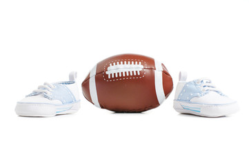 Football with baby shoes