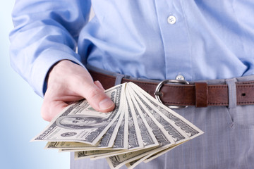 Money in the hand of the businessman