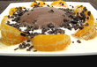 Schokoladenpudding mit Joghurt und Mandarinenscheiben und Schoko
