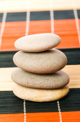 Stack of spa pebbles isolated on white