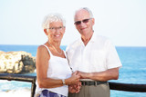 happy seniors on holidays - bright lifestyle portrait poster