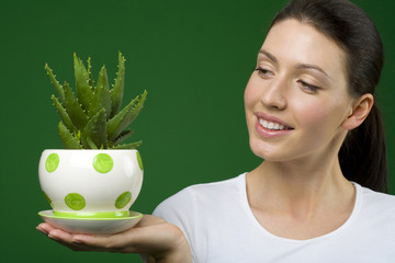 Woman holding aloe plant