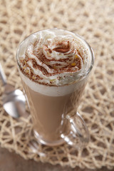 Coffee Latte whipped cream and cacao dust in rustic style