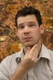 Male Rubbing Face poster