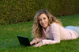 College Student studying outdoor with laptop