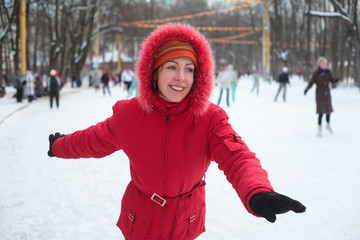 Young woman on skating rink in park