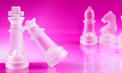 Chess coins on pink background chess board